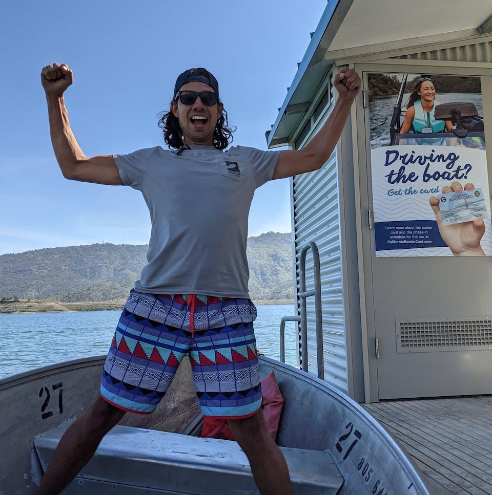 Young man posing for the camera on a boat at the dock at Lake Casitas near Ventura