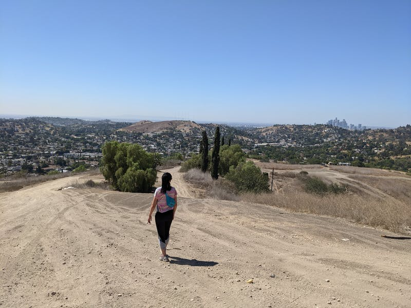 Hiker on wide open trail at Elephant Hill Open Space in Los Angeles