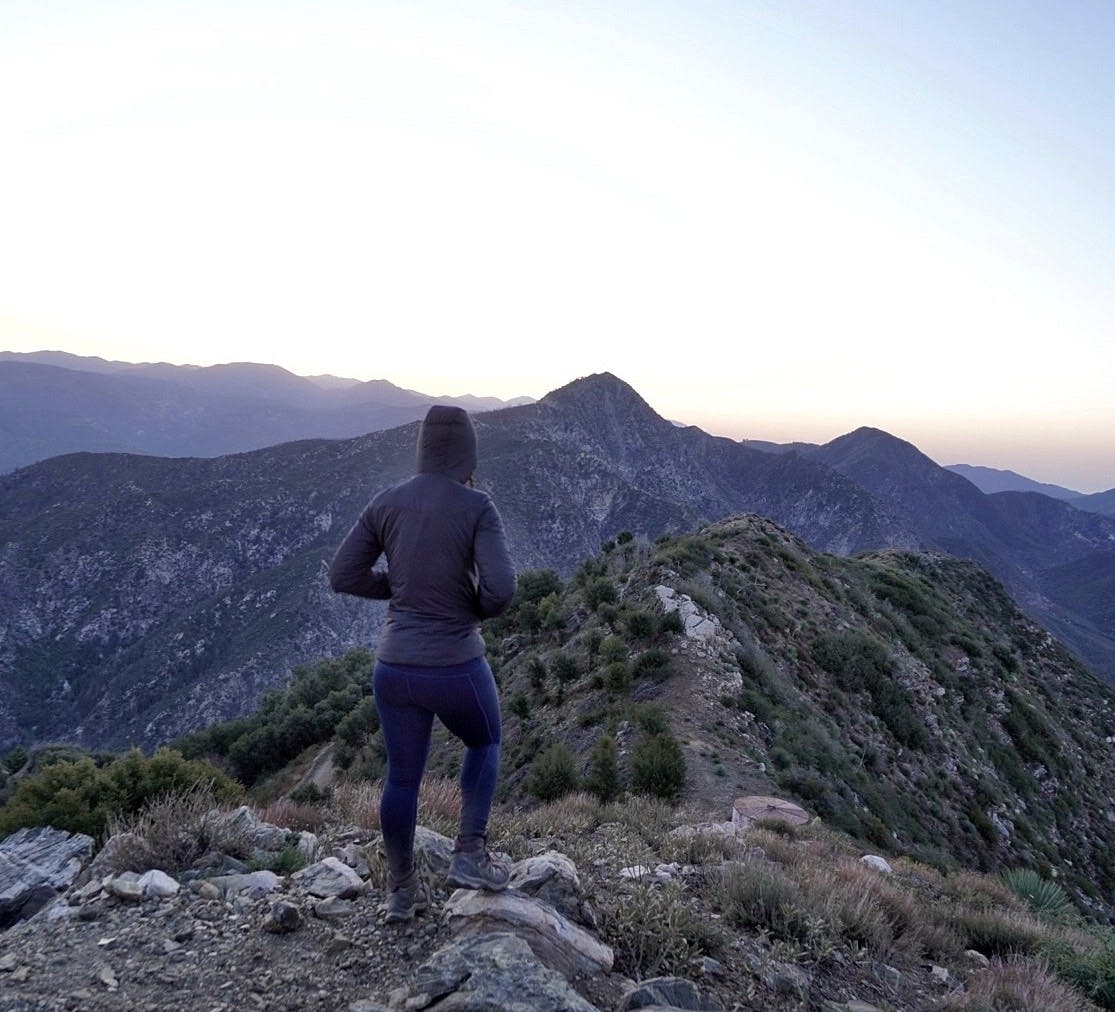 Woman looking out to the saddle of the hike to Josephine Peak in the San Gabriel Mountains