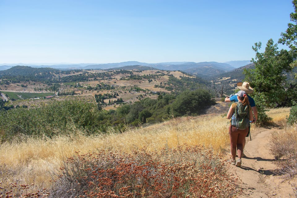 Hikers on the trail at Volcan Mountain Wilderness Preserve in San Diego County
