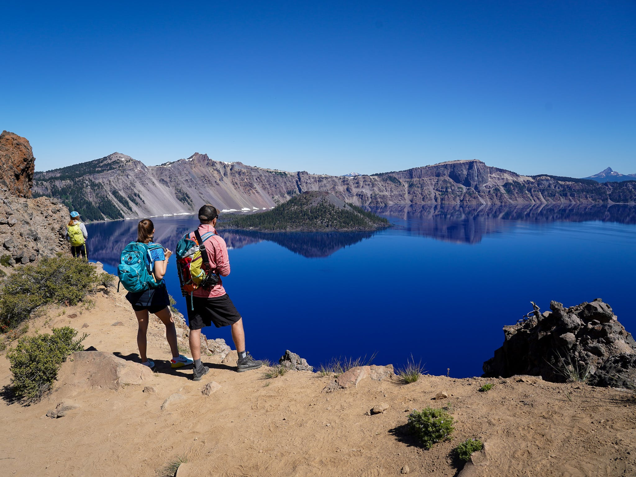 Couple standing at Garfield Peak Overlooking Crater Lake in Crater Lake National Park Southern Oregon