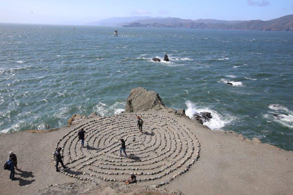 People walking th labyrinth in San Francisco near Mile Rock Beach