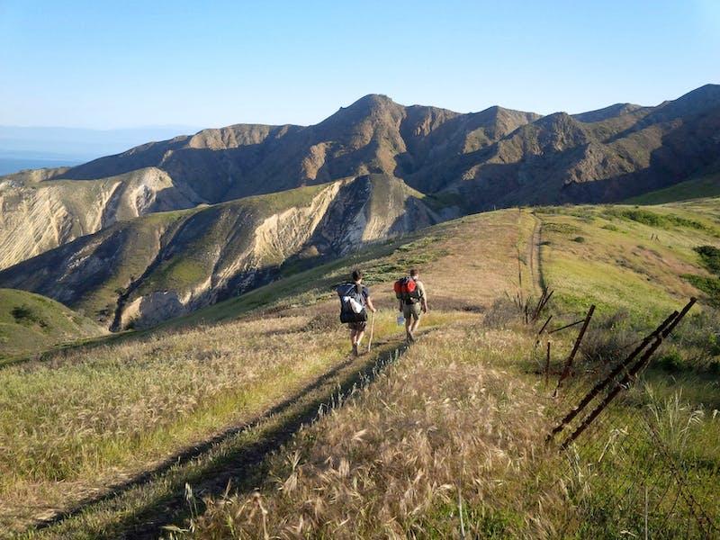 Backpackers traversing the seaside mountain range on Santa Cruz Island in Channel Islands National Park