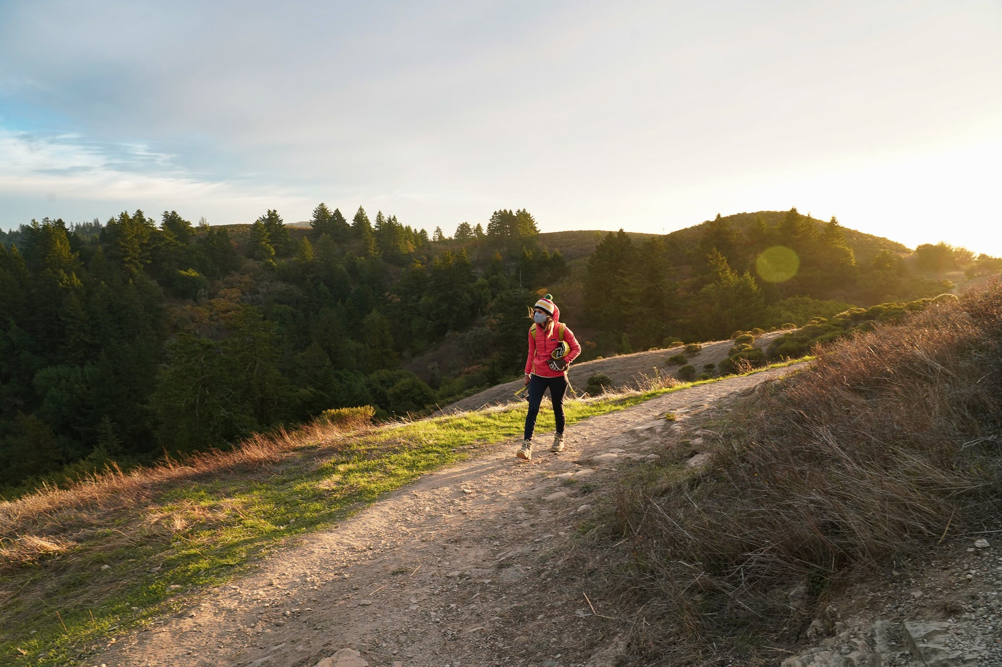 Woman hiking on the trail at Windy Hill Preserve