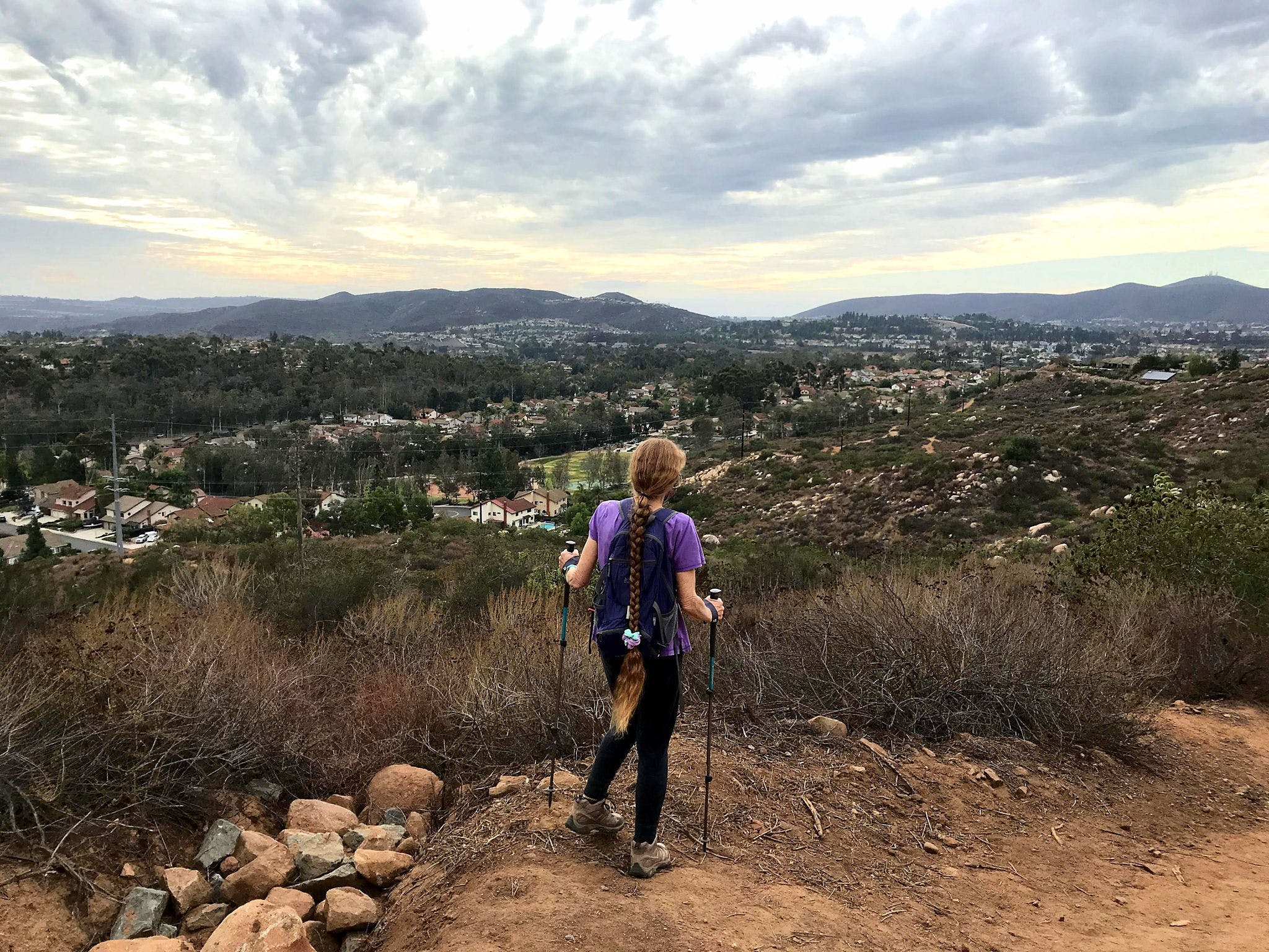 Woman on hiking trail to Twin Peaks in Poway San Diego County