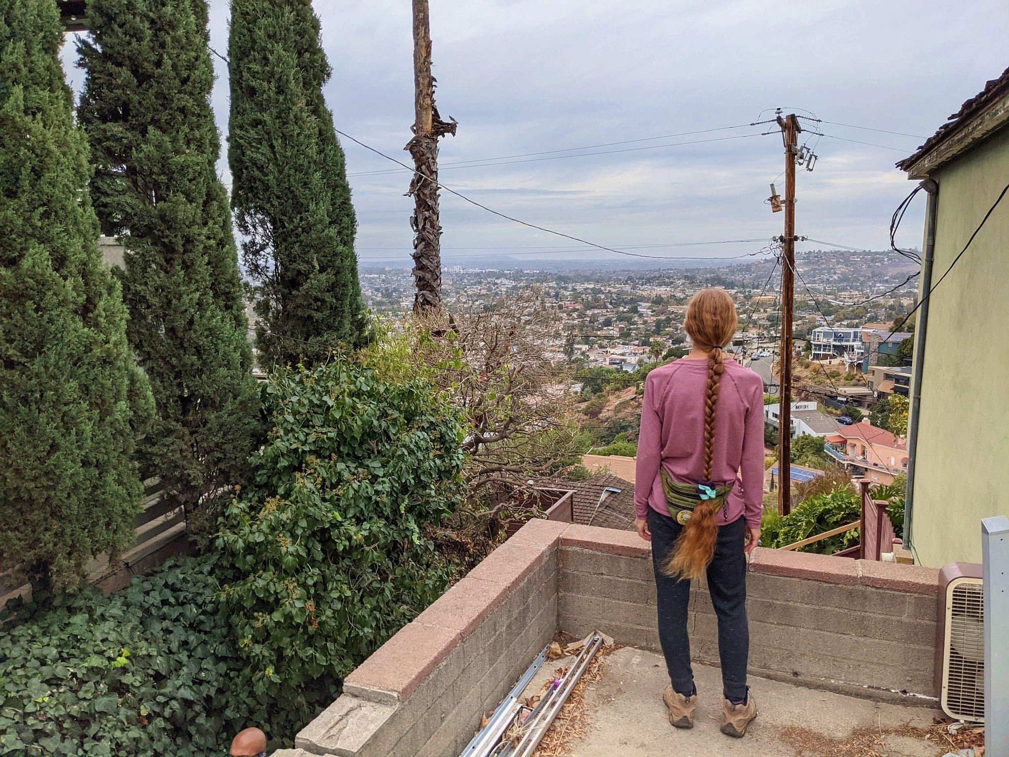Woman overlooking the scenery on a stairway walk in La Mesa San Diego