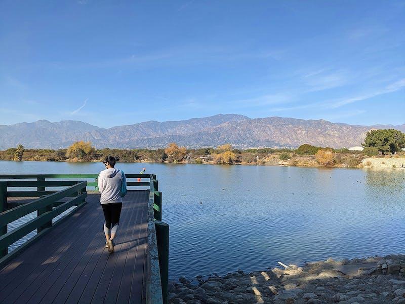 Woman on a boardwalk at Santa Fe Dam Recreation Area in Los Angeles County
