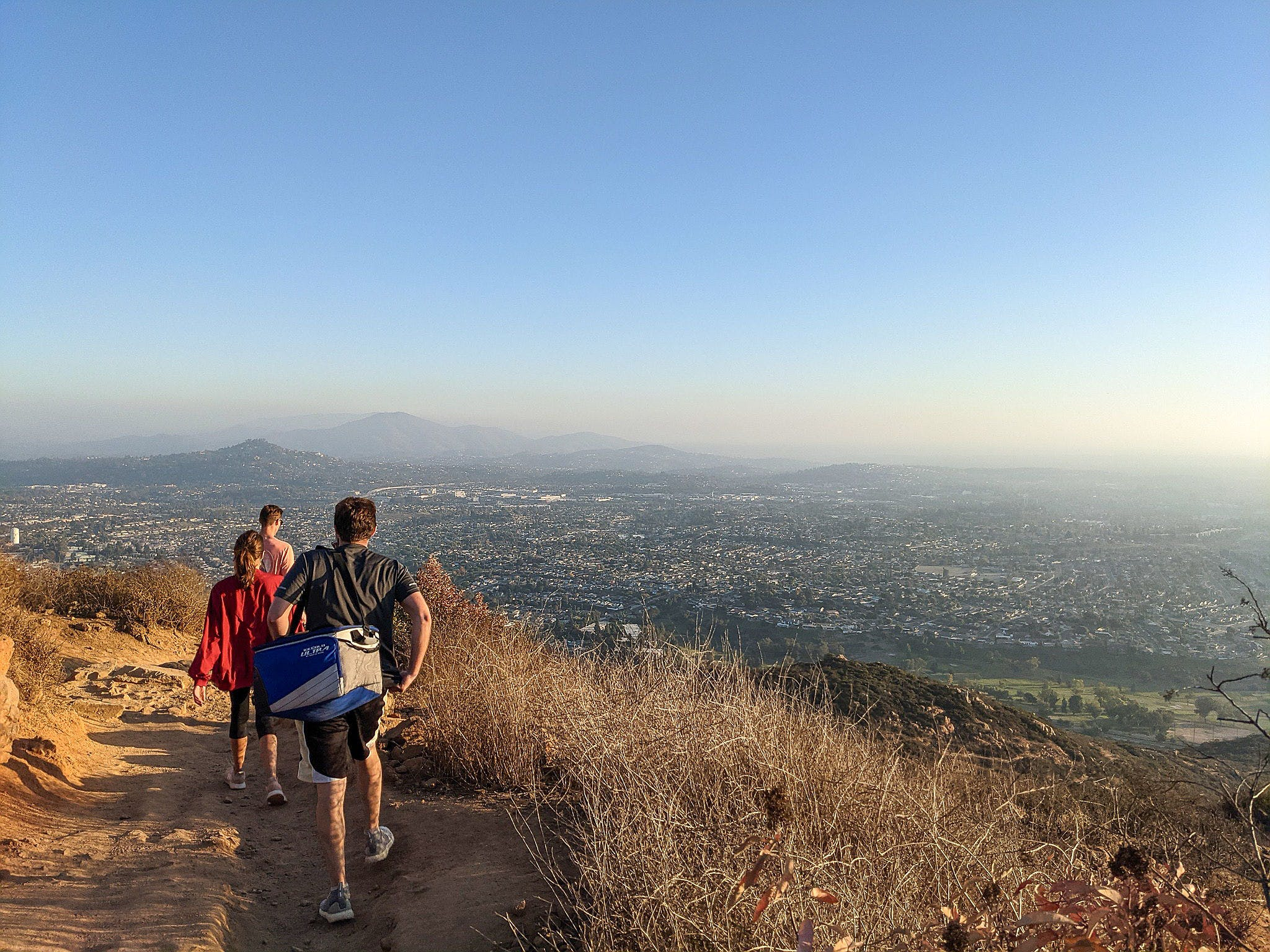 Friends walking down a hiking trail at Mount Cowles in San Diego