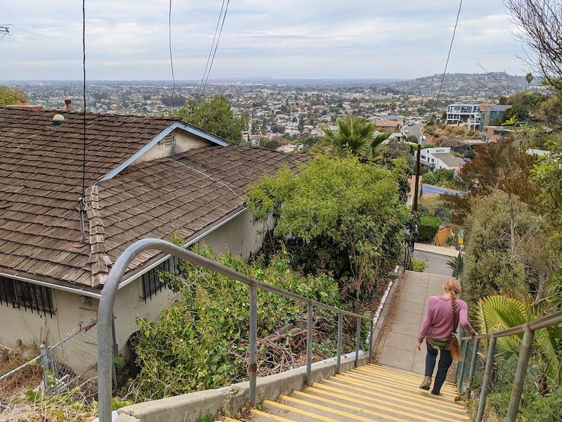 Woman walking down in a stairway in La Mesa San Diego County