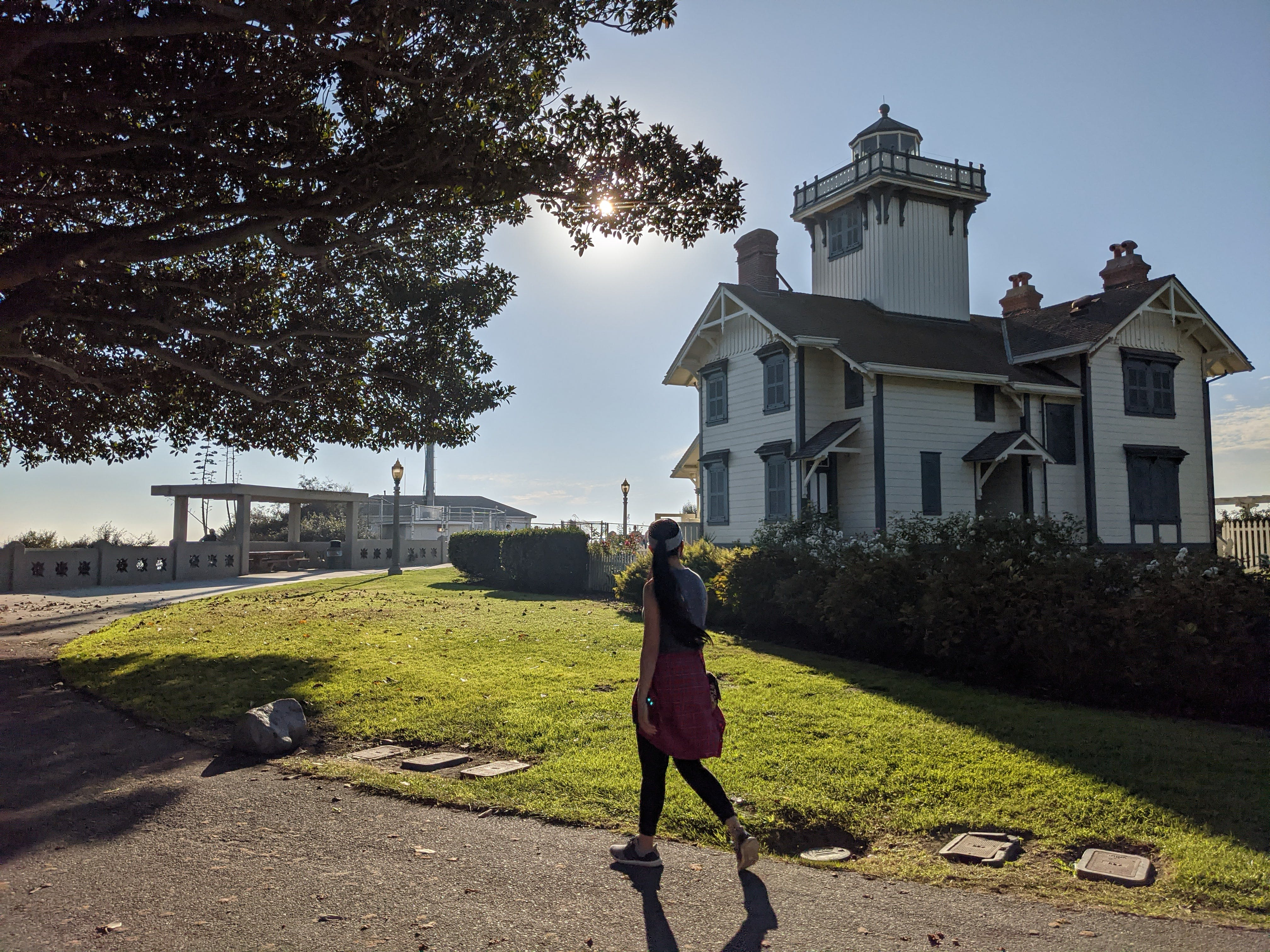 Woman hiking in front of Point Fermin Lighthouse in Los Angeles