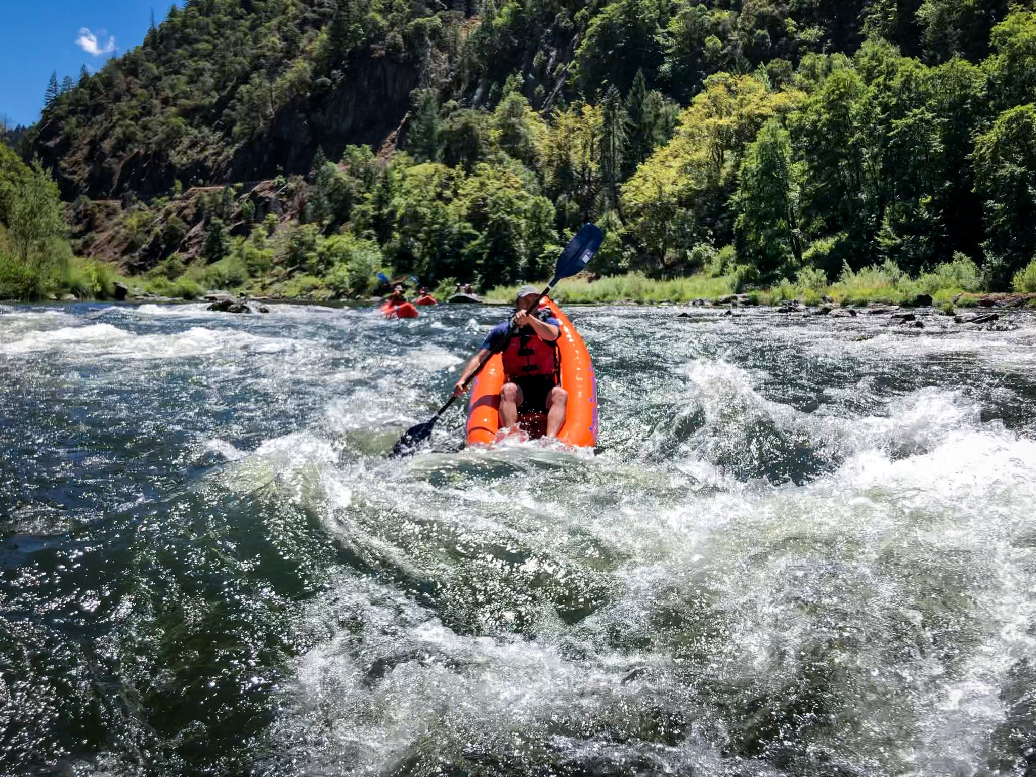 Kayaker in the rapids on the Rogue River in Southern Oregon
