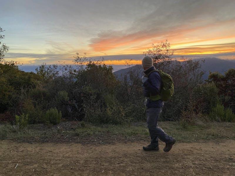 Man hiking the Aquinas Trail near sunrise in the South Bay at El Sereno Preserve