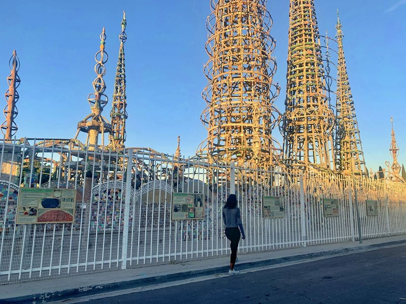 Woman looking at the Watts Towers in LA County