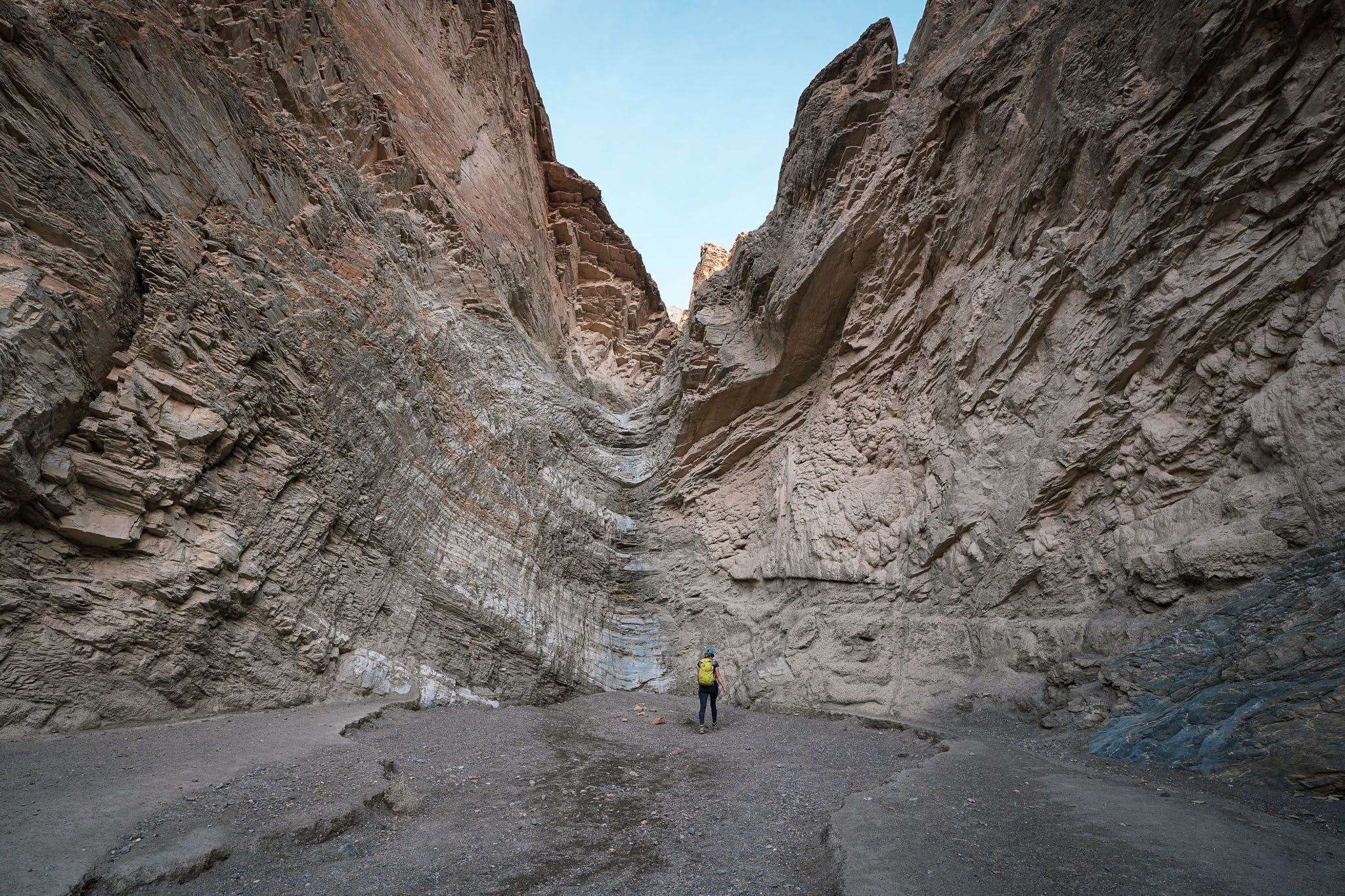 Woman standing at the vertical dryfall in Mosaic Canyon at Death Valley National Park