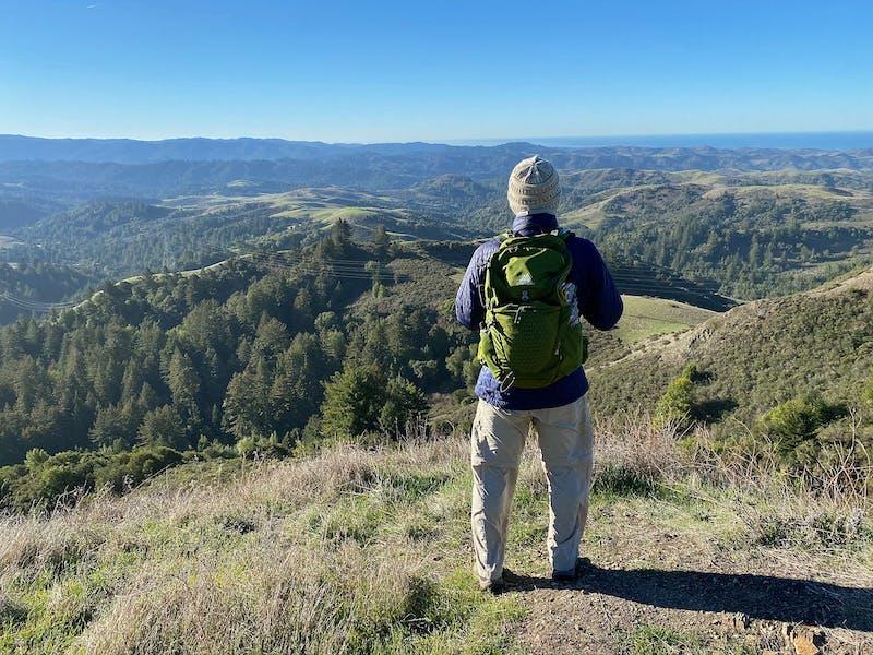 Hiker overlooking the Santa Cruz Mountains at Upper La Honda Creek Preserve