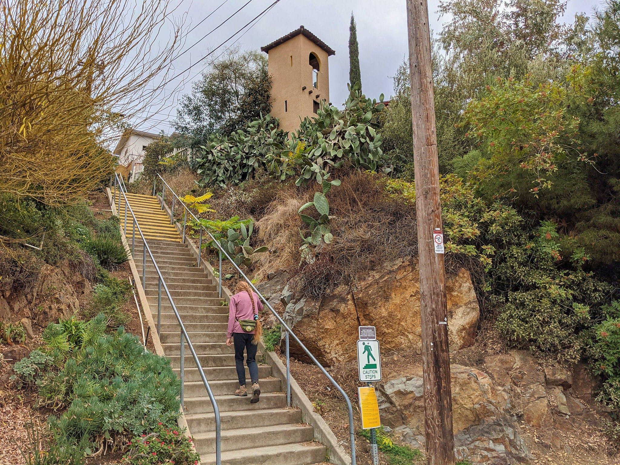 Woman walking up stairs in La Mesa San Diego
