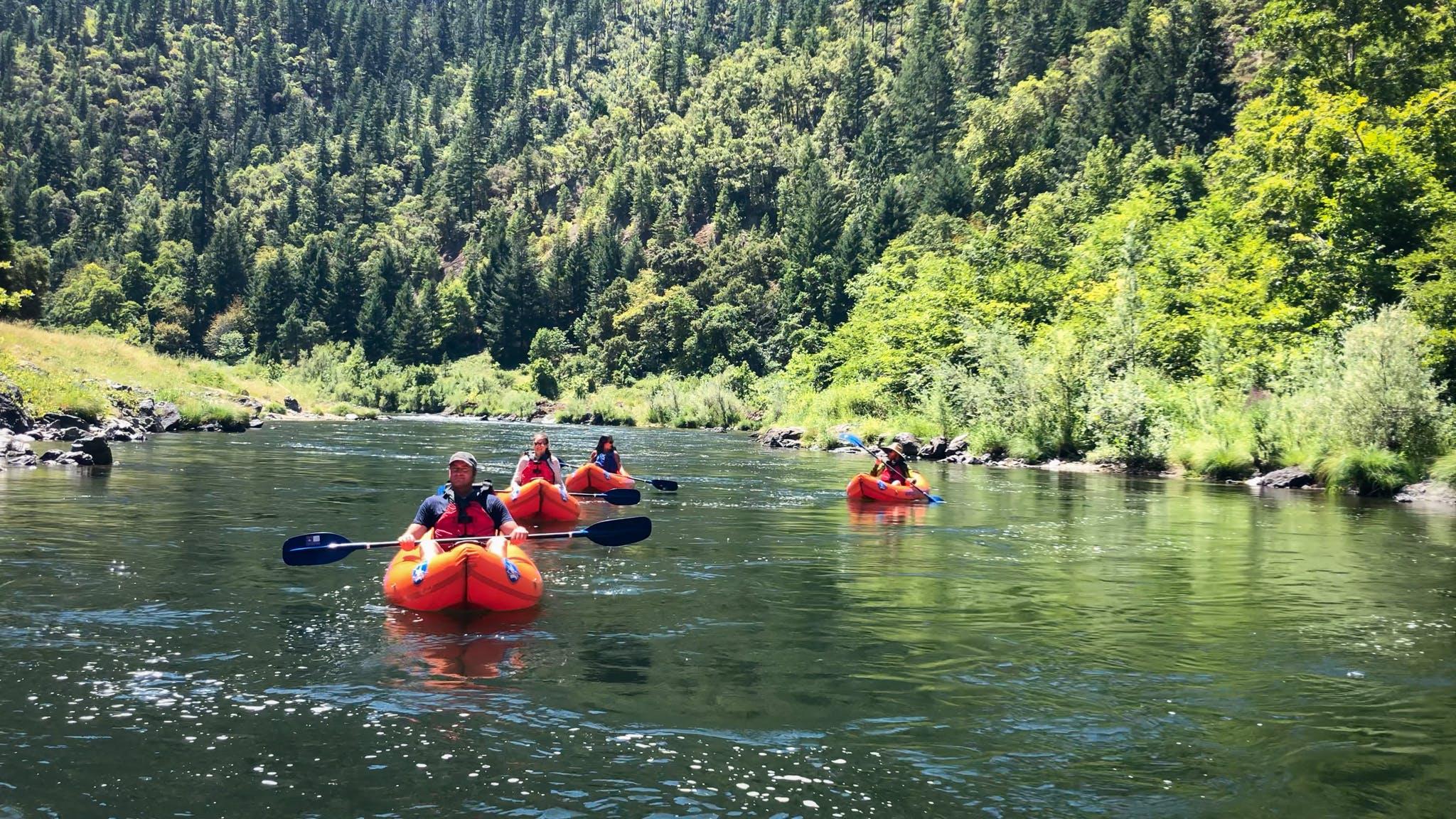 Inflatable kayak orange torpedo Rogue River