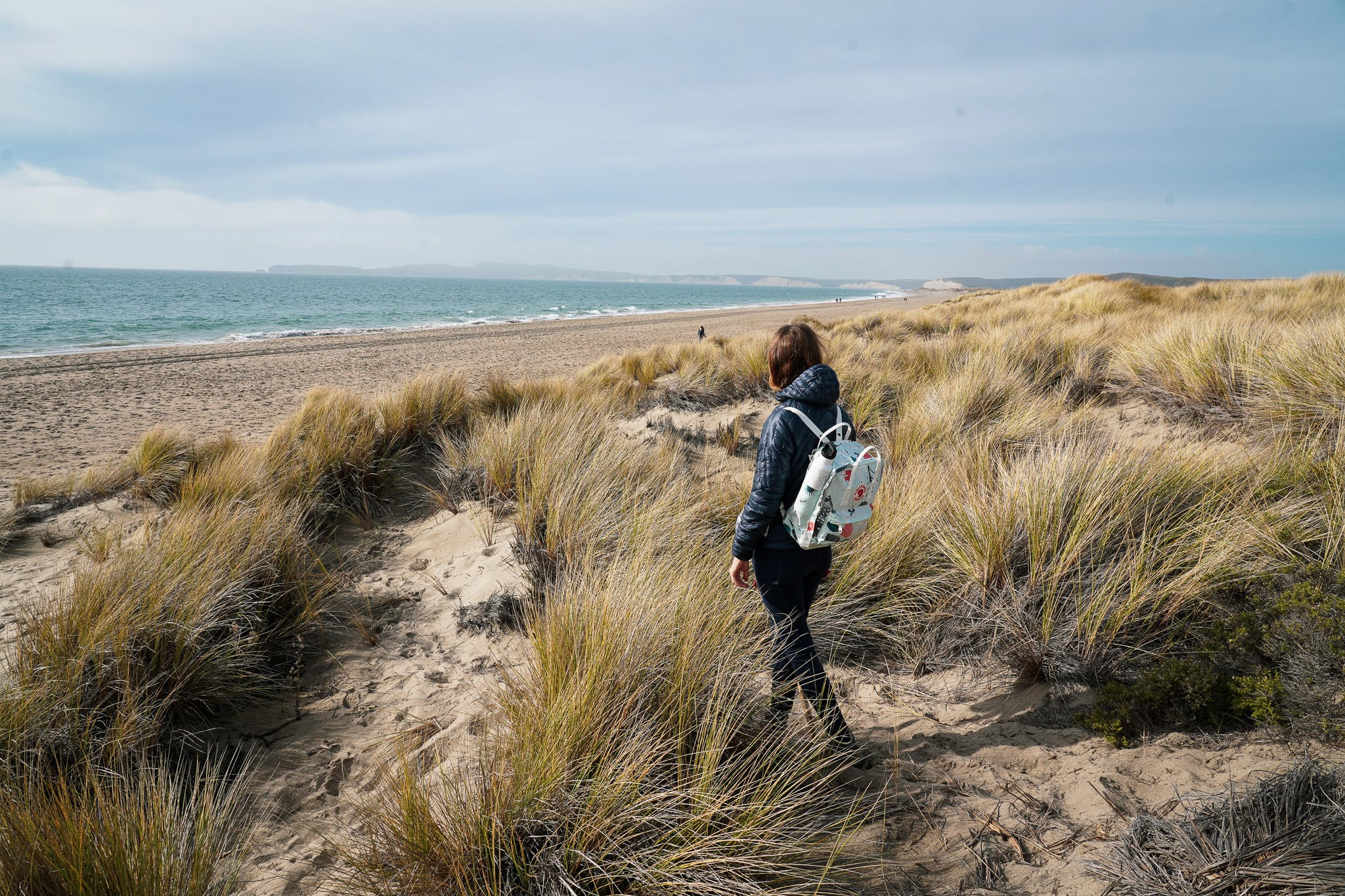 Woman hiking at Limantour Beach in Point Reyes