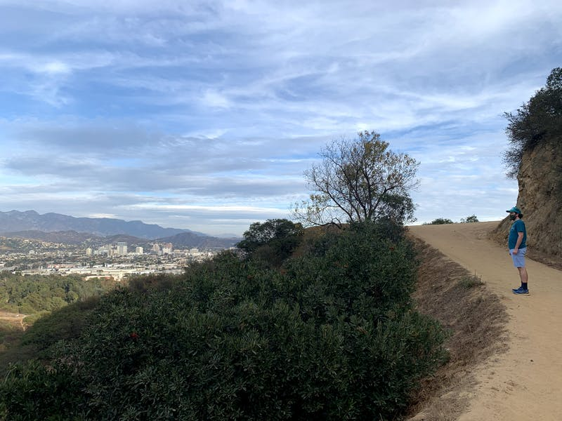 Man on hiking trail to Amir's Garden in Griffith Park Los Angeles