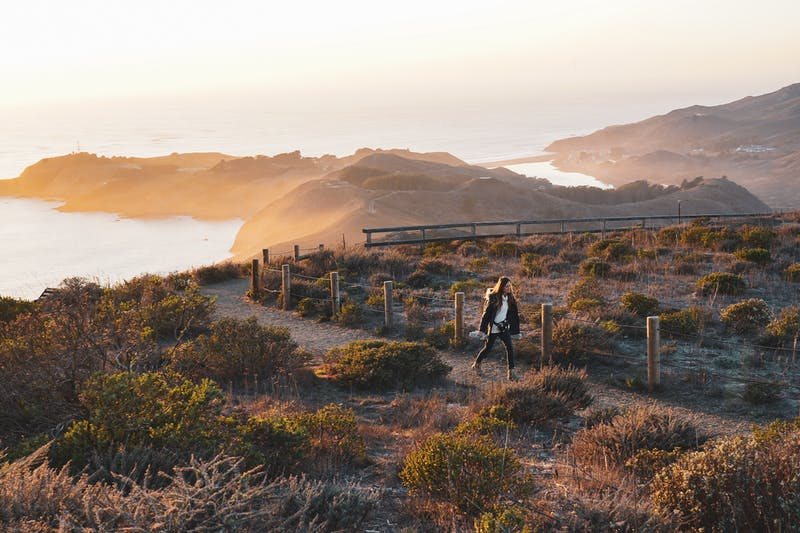 Woman hiking Hawk Hill in the Marin Headlands at Sunset
