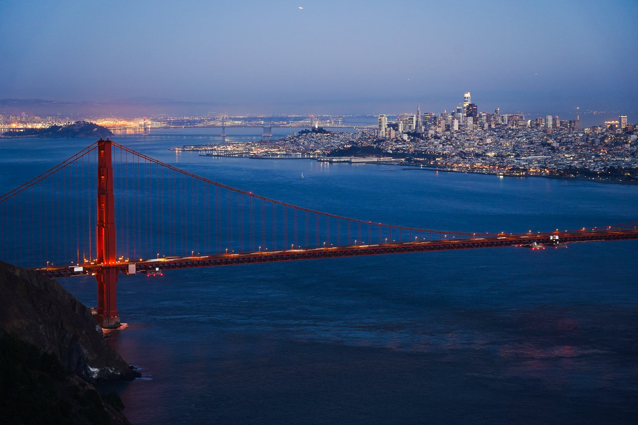 The Golden Gate Bridge and San Francisco sparkling at sunset