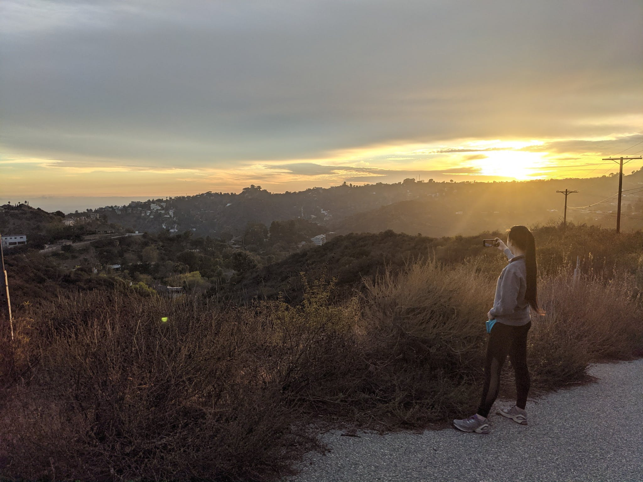 Woman taking in the view of Los Angeles at Briar Summit Preserve