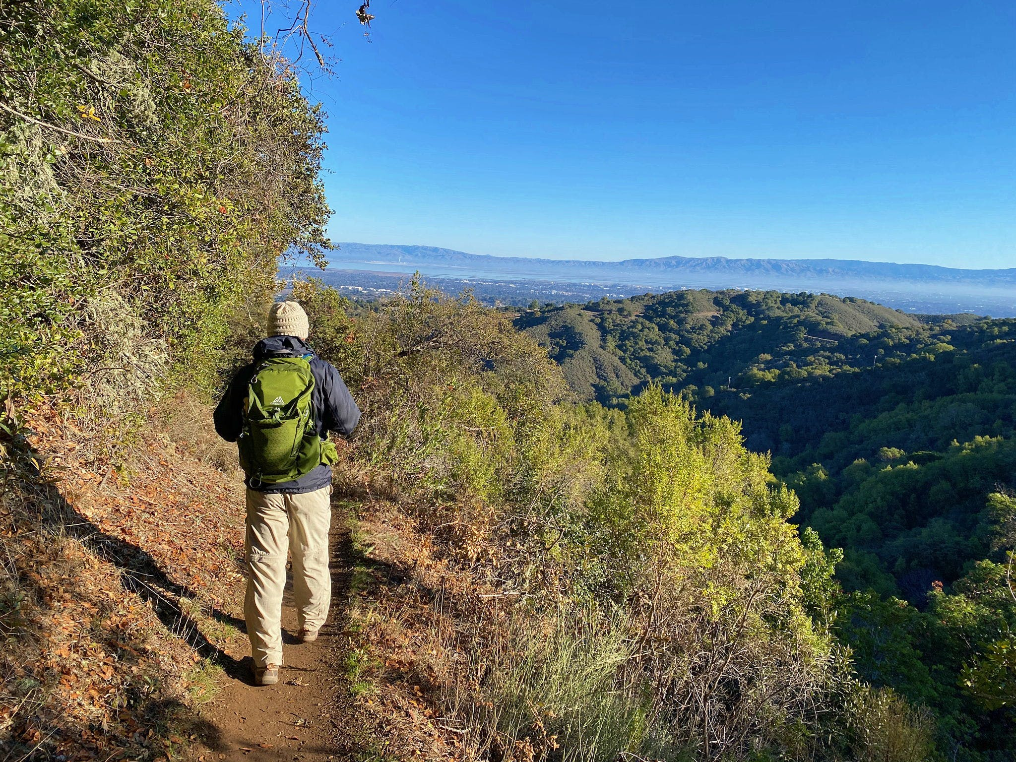 Man hiking a trail overlooking Palo Alto at Foothills Park