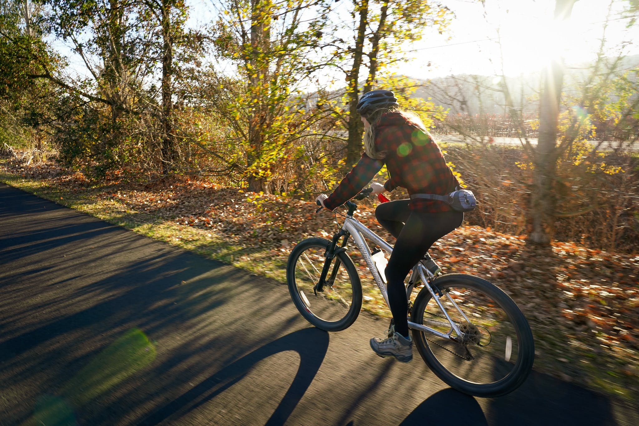 Woman biking on the Vine Trail in Napa Valley