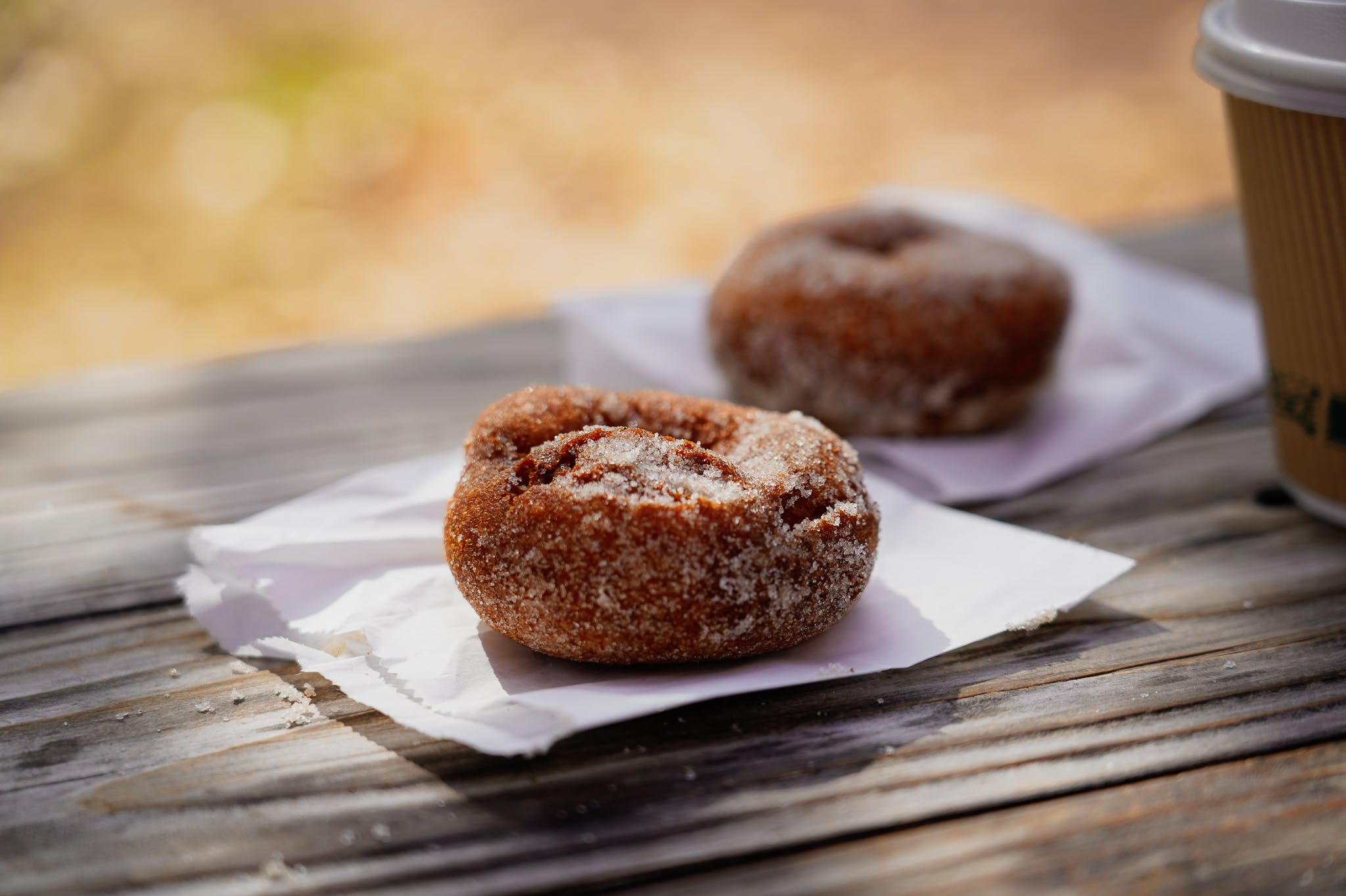 Two apple cider donuts from Rainbow Orchards on Apple Hill