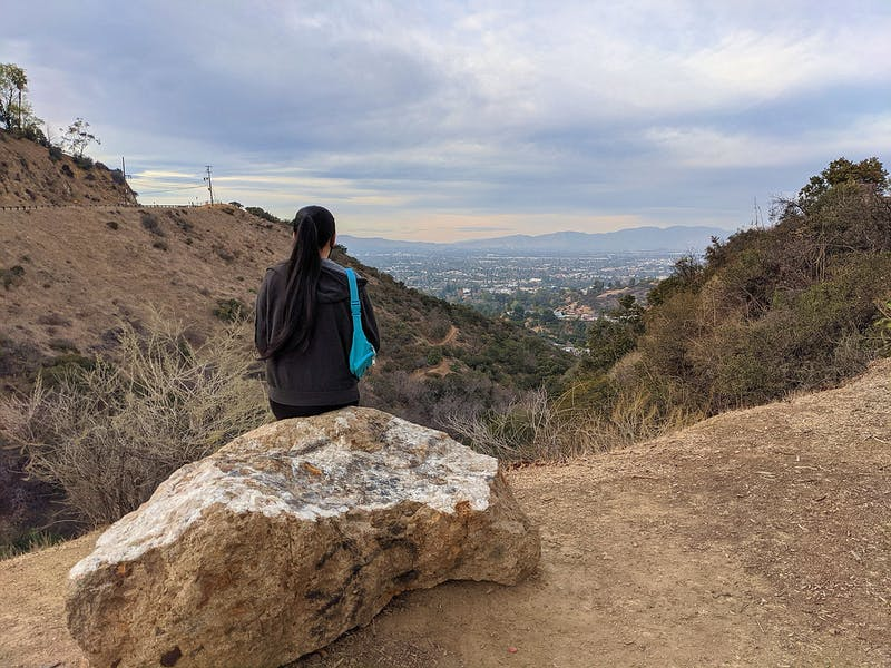 Woman at Nancy Hoover Pohl Overlook in Hollywood, taking in the views of San Fernando Valley