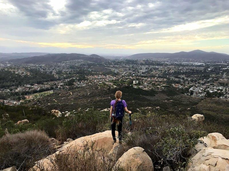 Woman standing at peak at Twin Peaks in San Diego