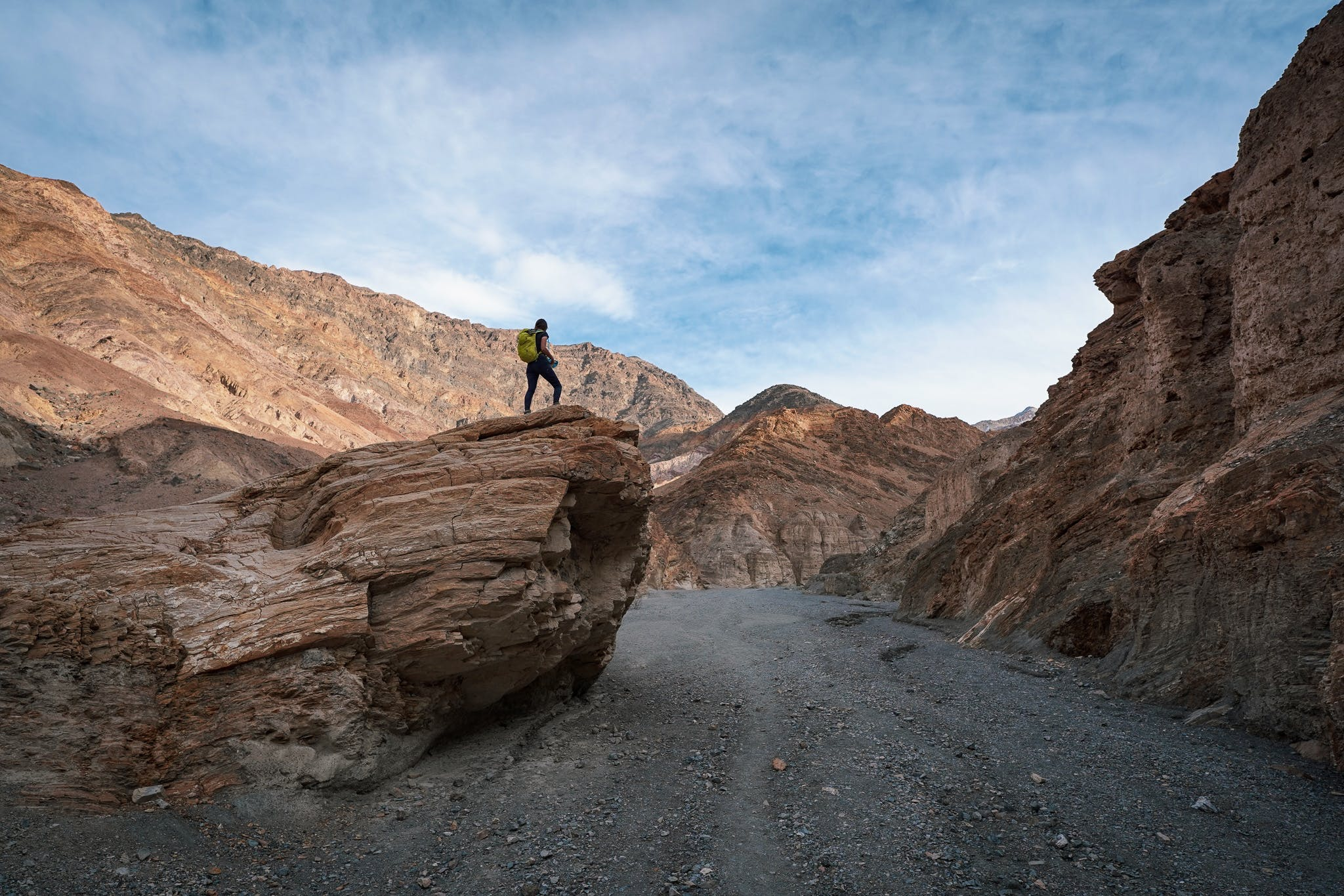 Woman on a large boulder overlooking Mosaic Canyon in Death Valley National Park