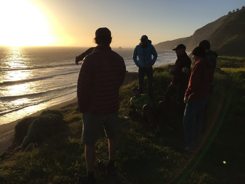 Group of friends at the beach at sunset near Wildcat Camp in Point Reyes National Seashore