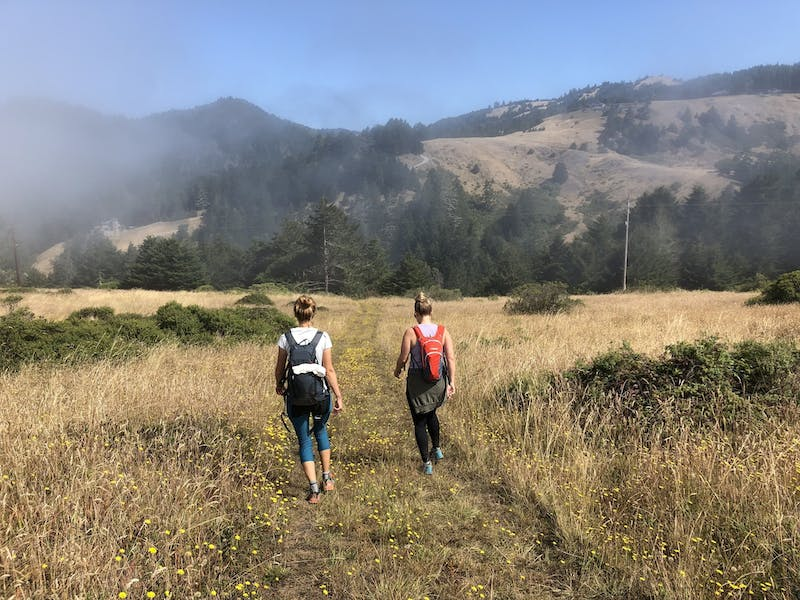Two women hiking a trail at Jenner Headlands on the Sonoma Coast