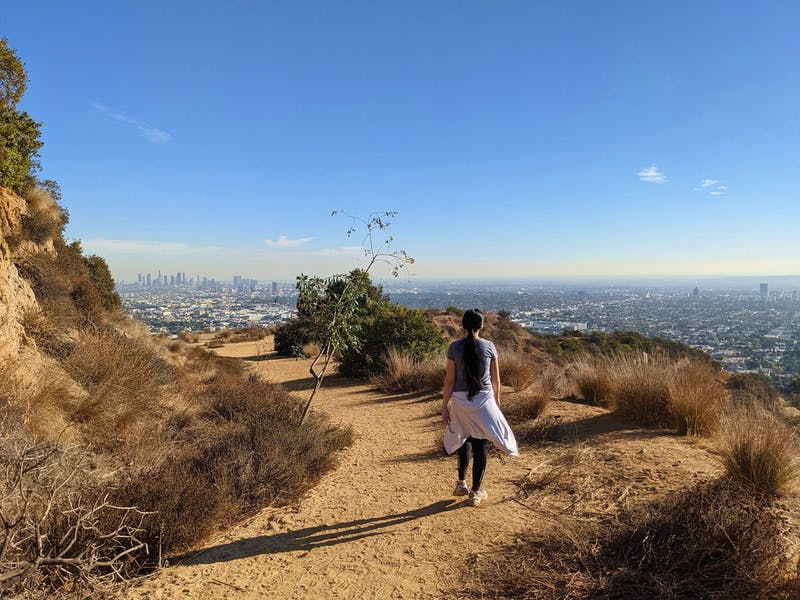 Woman hiking on the trail at Trebek Open Space in Los Angeles County