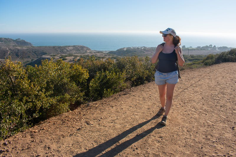 Woman hiking the backcountry trails overlooking the Pacific at Crystal Cove State Park