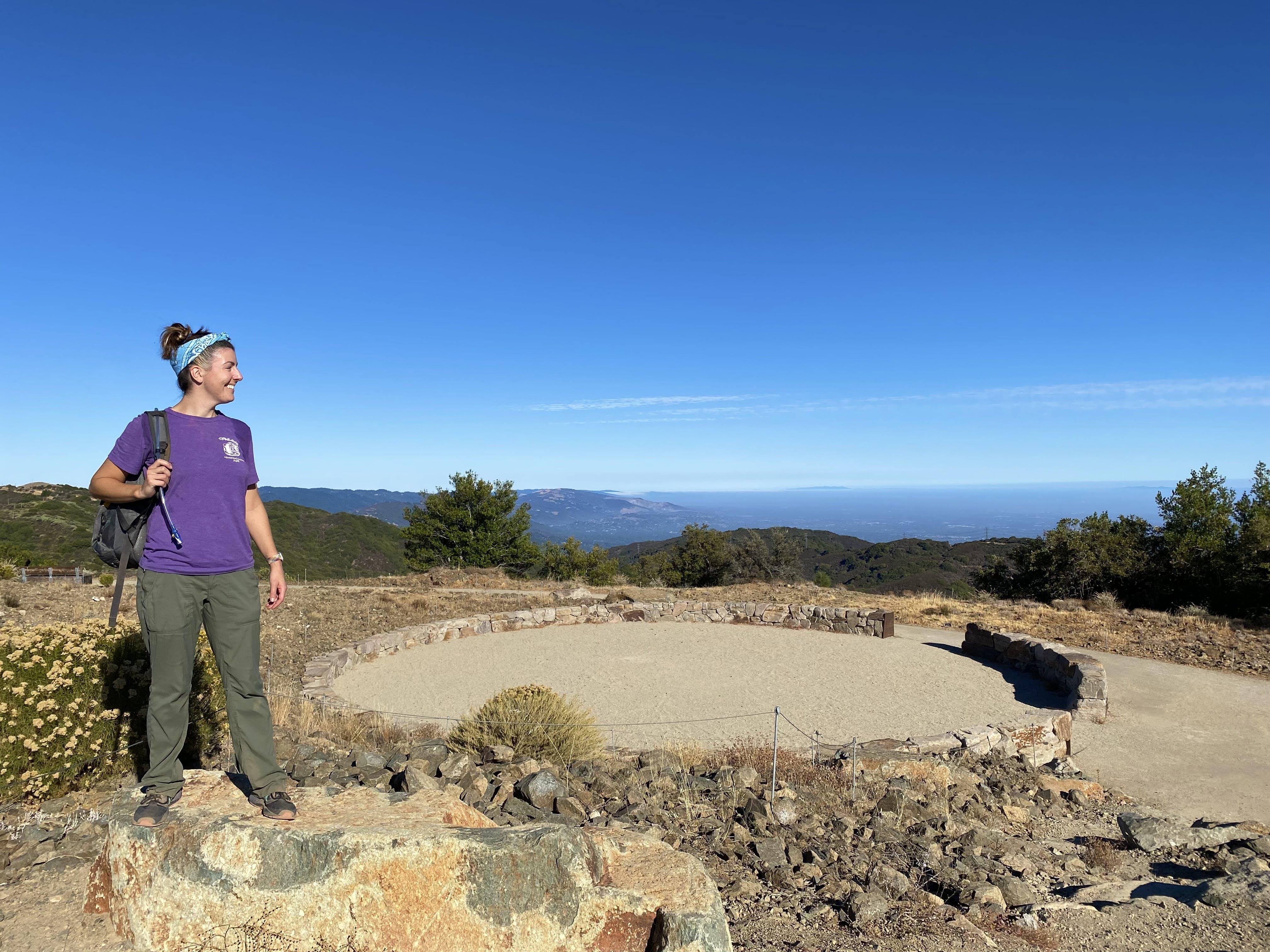 HIker at the Ceremonial Circle at the summit of Mount Umunhum in the Santa Cruz Mountains South Bay