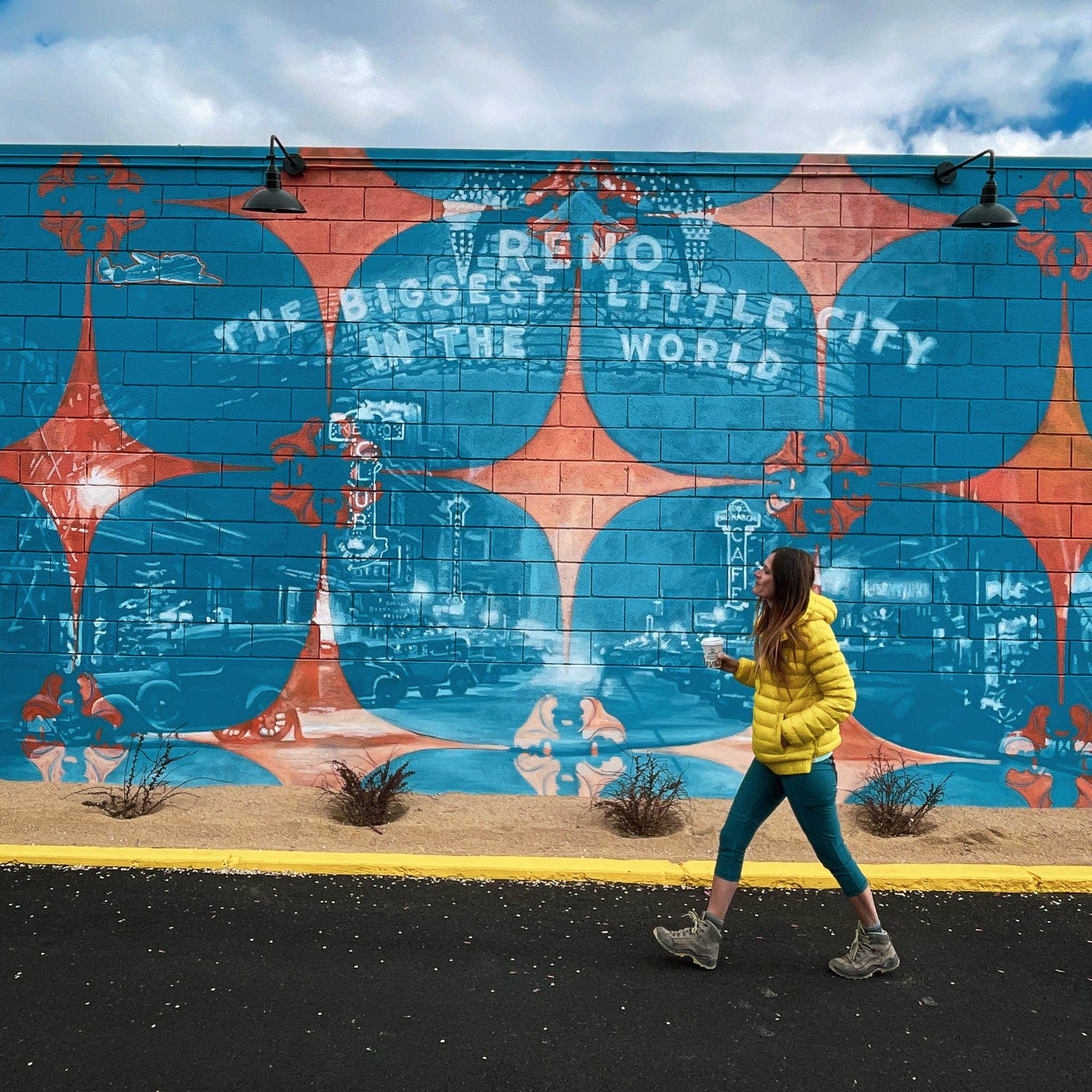 Woman walking by Kramer's Midtown mural in Reno