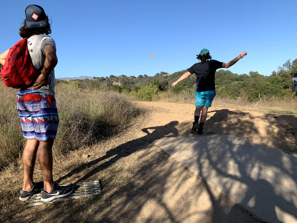 Friends playing disc golf at Coyote Point Disco Golf Course at Lake Casitas Recreation Area near Ventura