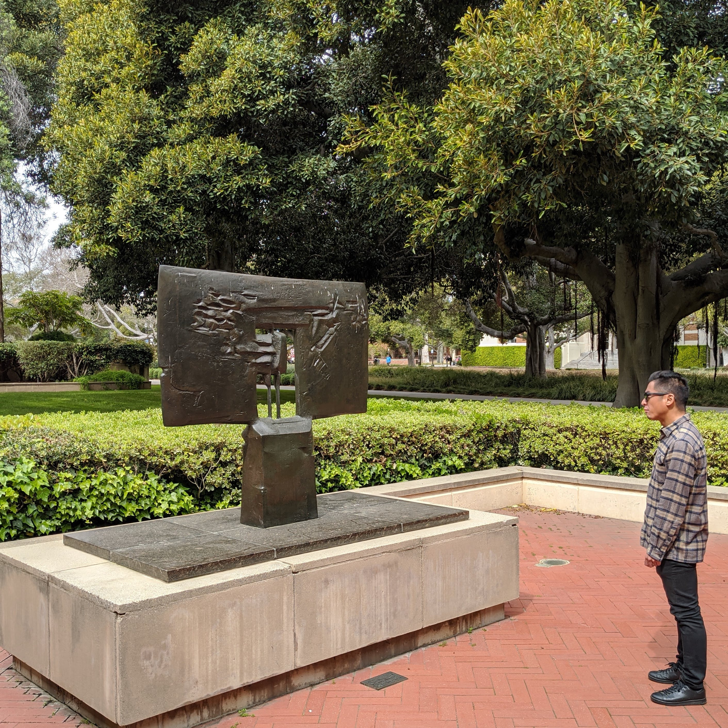 Person looking at outdoor sculpture on UCLA campus