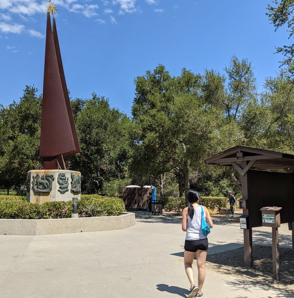 Woman hiking through the entrance to Whiting Ranch Wilderness Park in Orange County