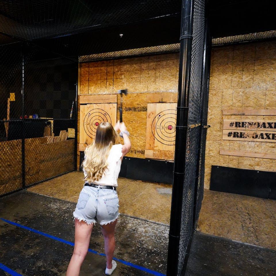 woman throwing axe at Reno Axe