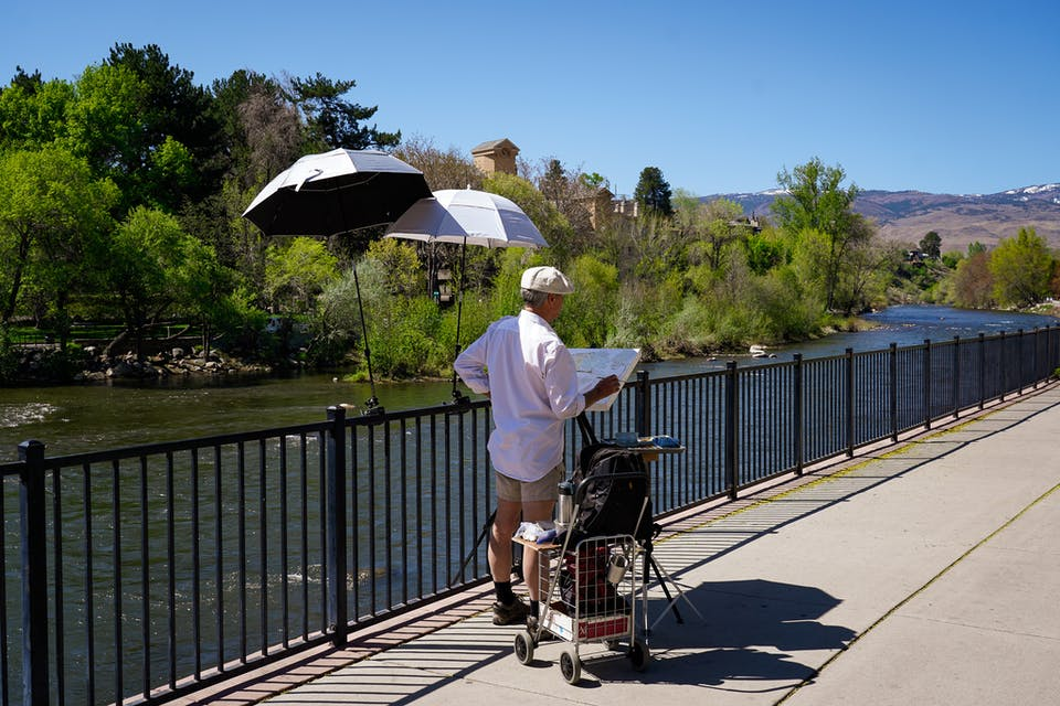 Painter standing at Truckee River in Reno