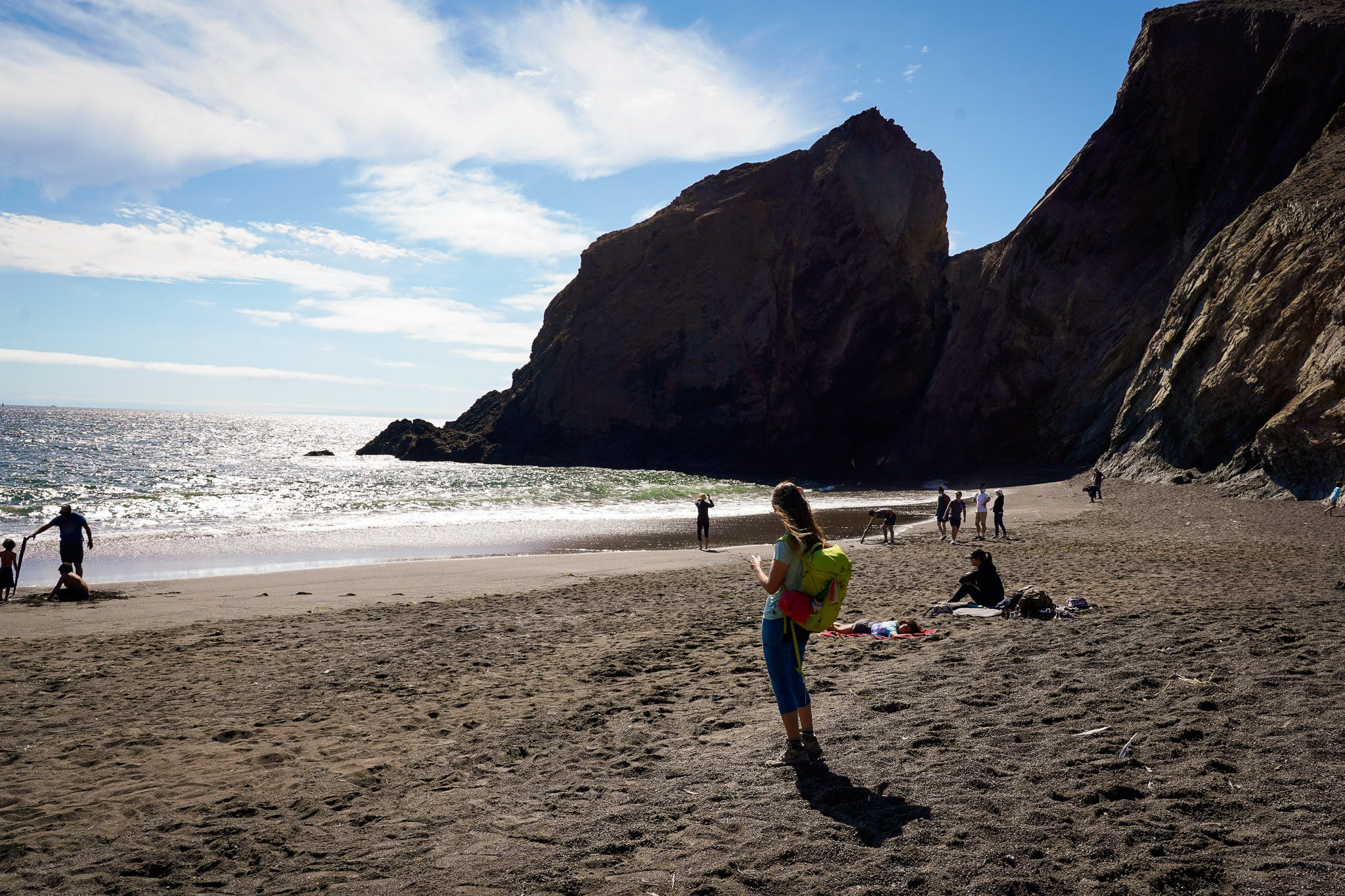 Woman on Tennessee Cove beach in the Marin Headlands