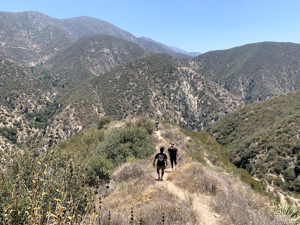 Hikers descending into a canyon in the Angeles National Forest Southern California