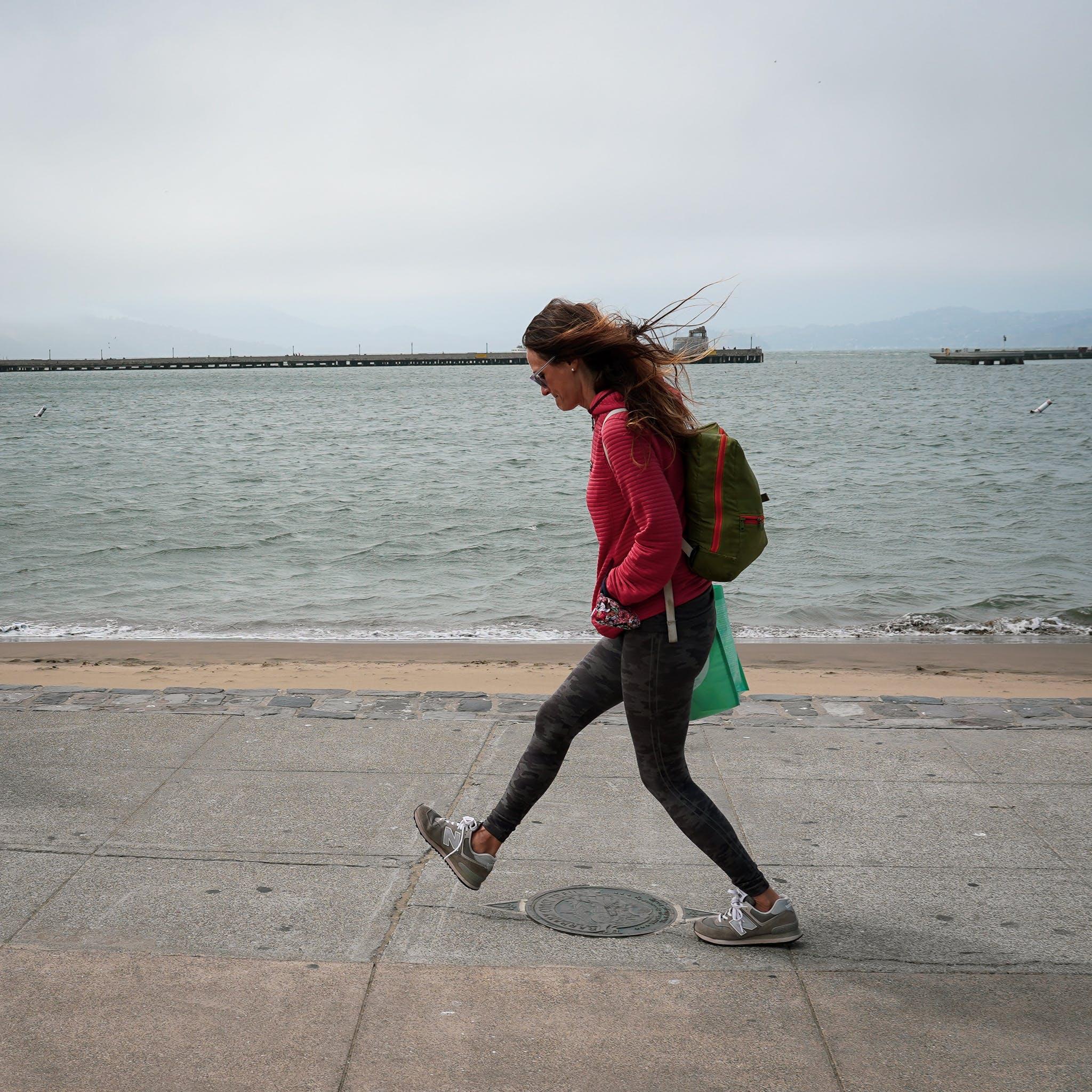 woman walking the Barbary Coast Trail medallion San Francisco