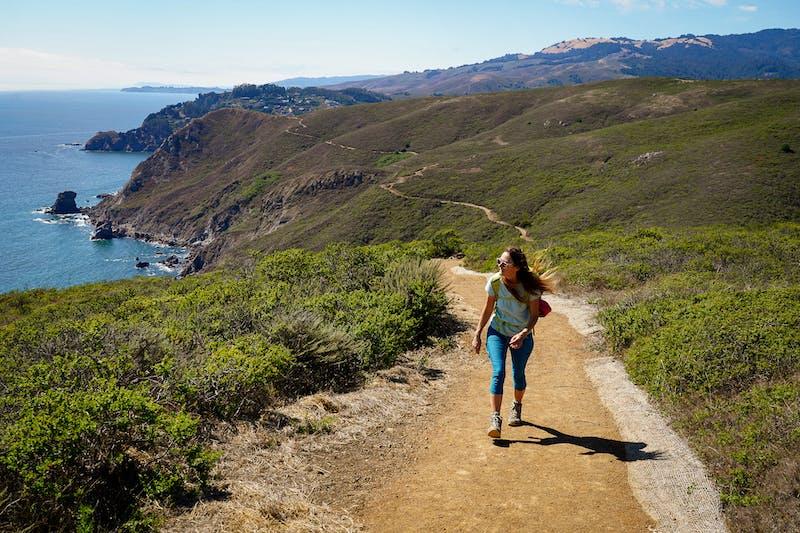woman hiking the Coastal Trail in Marin Headlands