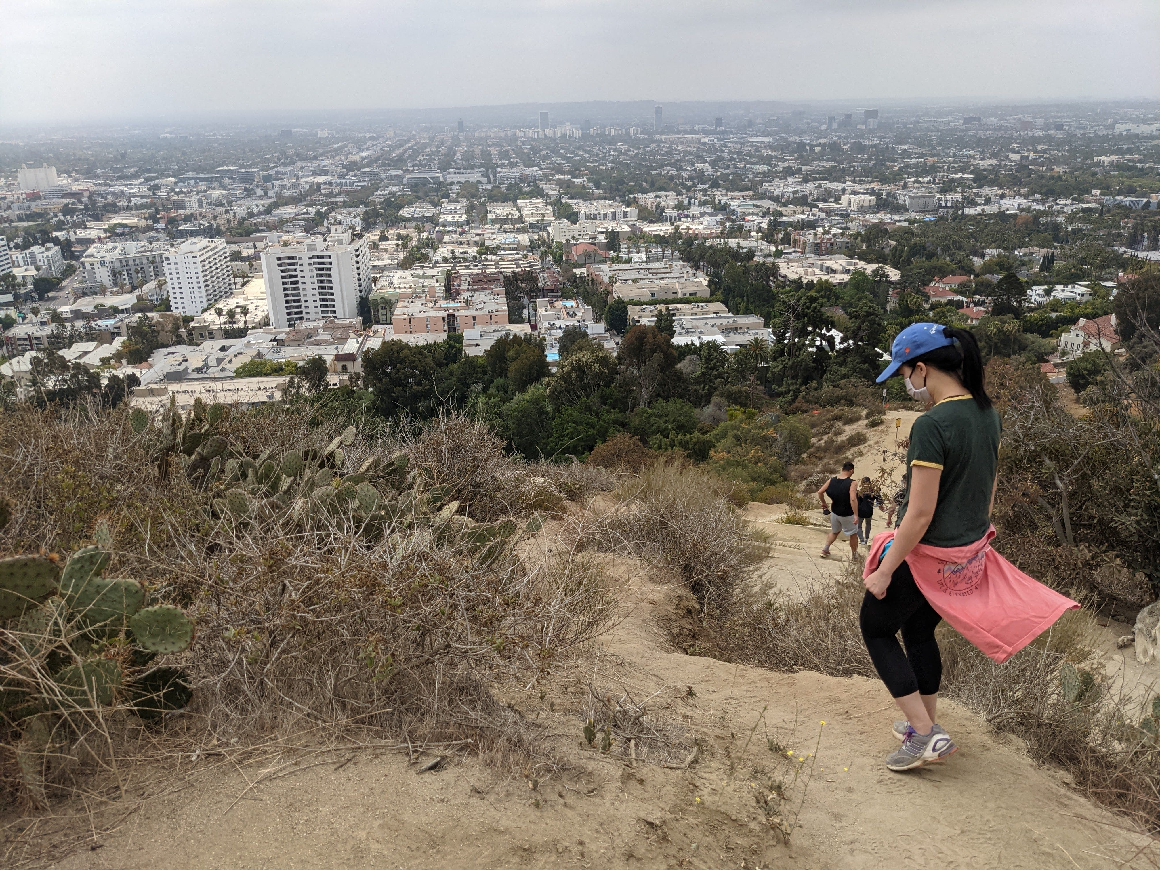 Hiker about to start down a trail at Runyon Canyon in Los Angeles