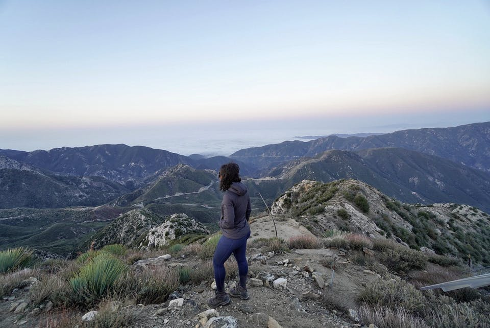 Woman looking out to the San Gabriels from Josephine Peak