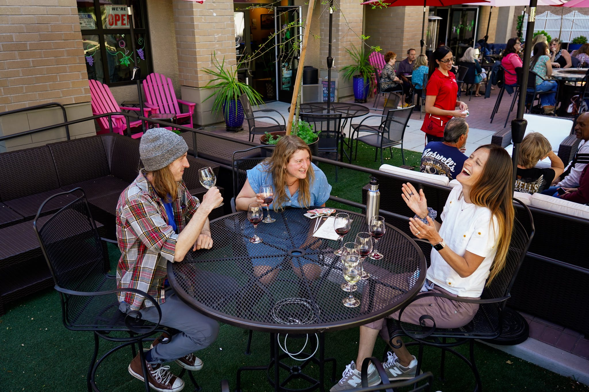 Group hanging out on a patio at Engine 8 Urban Winery